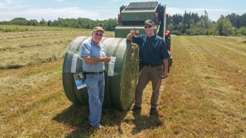 Mr Bonnyman - beef farmer (left) and Arden Little of Green Diamond Equipment (right)